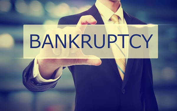 Business man holding Bankruptcy