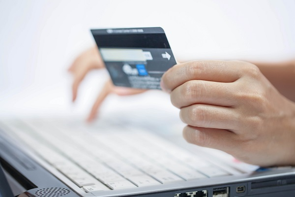 Using a credit card for online shopping.
